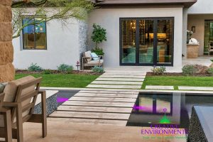 Backyard custom landscape with zero edge pool with floating steps to floating patio