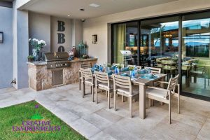 Small backyard patio area with built in barbecue and outdoor dining table