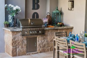 Custom hardscape built in barbecue with outdoor dining table