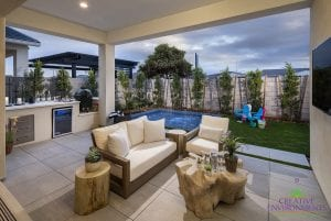 Custom outdoor landscape in Arizona backyard patio with small swimming pool and lounge area