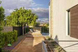 Custom outdoor landscape in Arizona on side of yard with bocce ball court