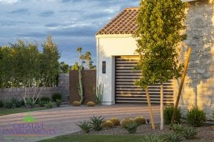 Custom outdoor landscape in Arizona in the driveway with pavers