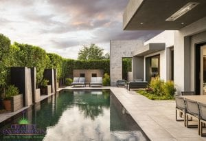 Custom outdoor landscape in Arizona backyard with custom swimming pool and metal water features