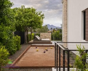Custom outdoor landscape in Arizona on side yard with bocce ball court