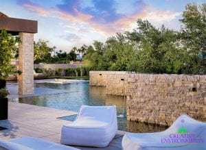 Custom outdoor landscape in Arizona backyard with large custom pool and water features