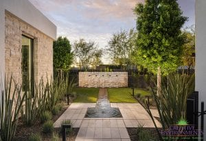 Custom outdoor landscape in Arizona on side yard with fountain