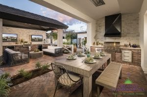 Custom outdoor landscape in Arizona patio area in backyard with outdoor dining and entertainment area