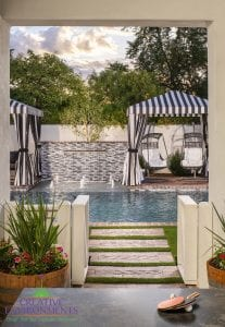Custom outdoor landscape in Arizona backyard custom pool with water features and canopies