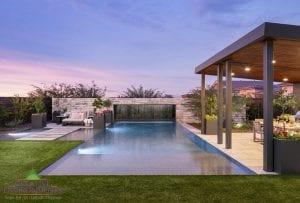 Custom outdoor landscape in Arizona backyard swimming pool with zero edge near patios with large waterfall