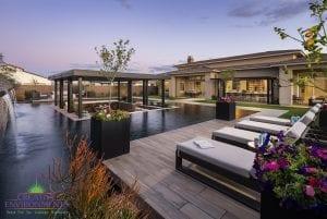 Custom outdoor landscape in Arizona backyard zero edge pool with inset lowered patio and lounge area