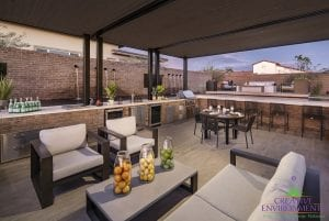 Custom outdoor landscape in Arizona backyard covered patio with lounge area and outdoor dining near plants and water features