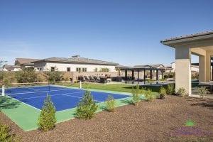 Custom outdoor landscape in Arizona backyard sports court and tennis court near desert landscape