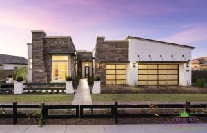Custom outdoor landscape in Arizona front yard with grass area and desert landscape leading up to large home