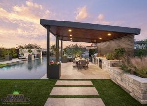 Custom outdoor landscape in Arizona backyard covered patio with large awning and outdoor kitchen and dining near swimming pool