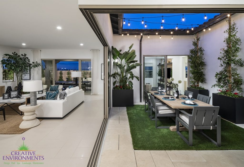 Creative Environment design and landscape in Scottsdale showing patio in center of home with dining and string lights