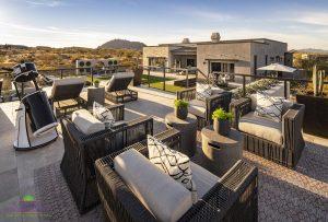 Creative Environments design and landscape at Sereno Canyon Mayne Model showing backyard raised patio with seating