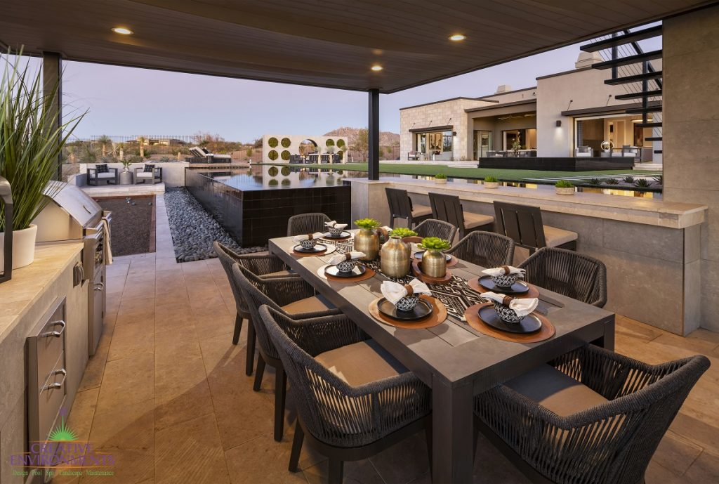 Creative Environments design and landscape at Sereno Canyon Mayne Model showing backyard covered patio with dining area
