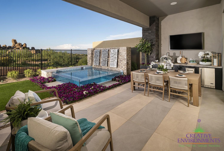 Creative Environments custom backyard with glass swimming pool and custom patio