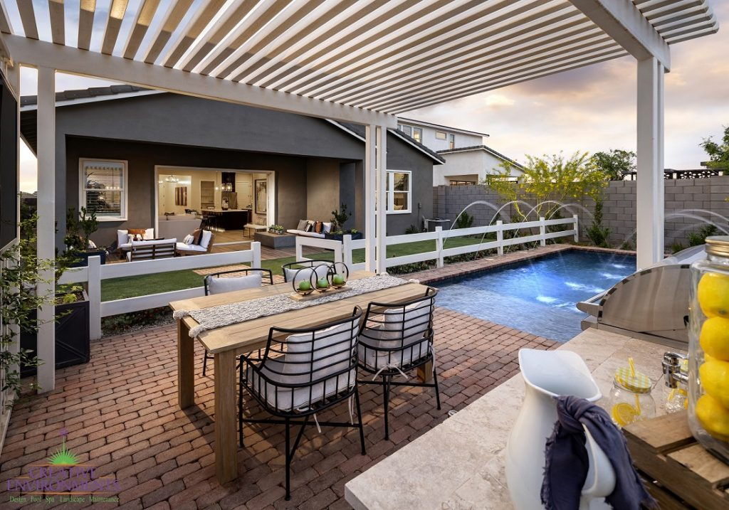 Creative Environments design and landscape at Cadence Model showing backyard with pergola over dining area and swimming pool