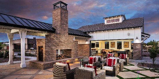 Custom backyard landscape with large chicago brick fireplace and outdoor seating near clubhouse