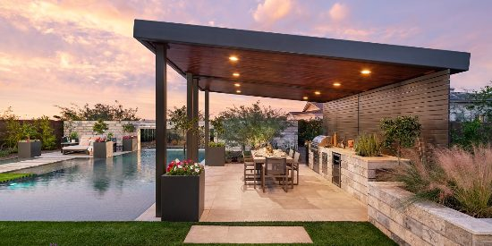 Custom backyard landscape with huge covered patio near a large custom pool