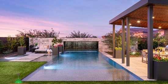Custom backyard landscape with large pool and floating patio space near covered outdoor kitchen